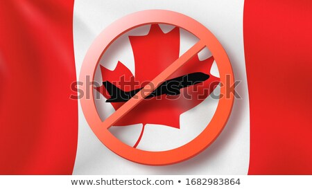Warning sign with crossed out plane on the background of Canadian flag. Stock photo © artjazz