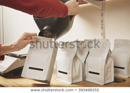 Man and woman with freshly roasted coffee Stock photo © Kzenon