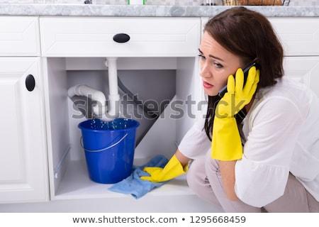 Woman With Emergency Plumbing Sink Leak Stock photo © AndreyPopov