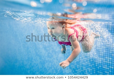 Small girl in a pool Stock photo © Zela