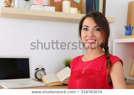 Woman in red dress half-turn smiling. Stock photo © Paha_L