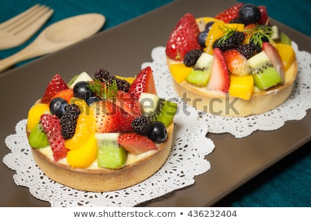 Strawberry and custard tart with dessert fork Stock photo © aladin66