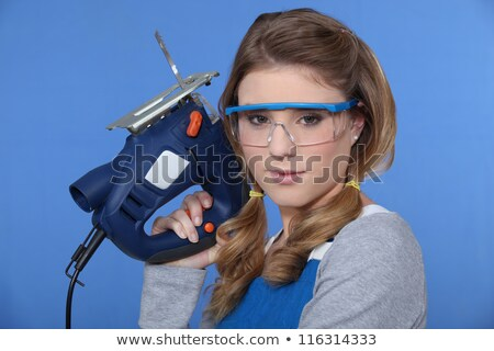 young handywoman posing with saw stock photo © photography33