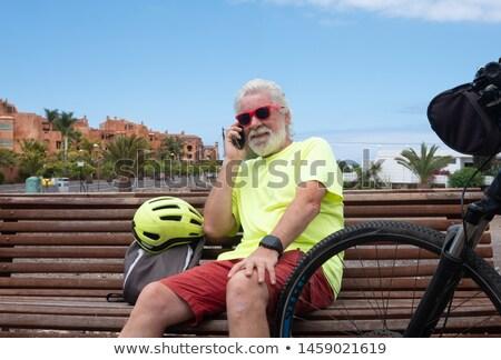 пожилого человека сидят стены морем небе Сток-фото © photography33