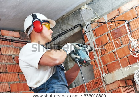worker drilling wall stock photo © photography33