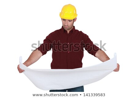 Tradesman examining a technical drawing Stock photo © photography33