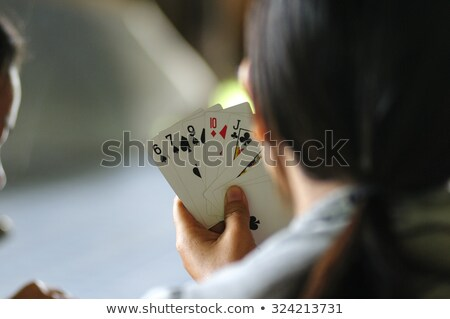 Teenage girls holding playing cards Stock photo © photography33