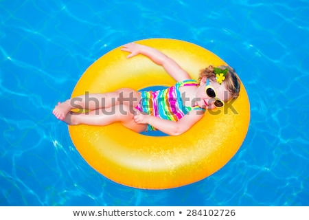 little girl with sunglasses and inflatable ring stock photo © jirkaejc