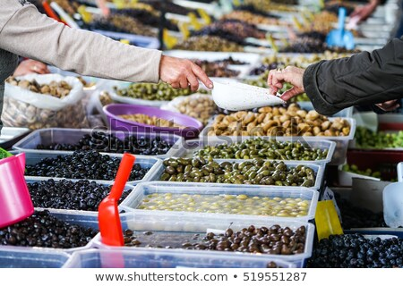fresh organic different types of olives at a street market in is stock photo © kuzeytac