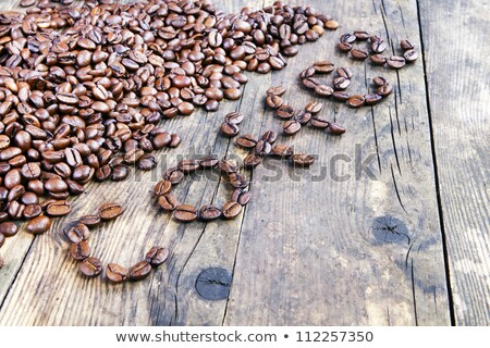 The word coffee beans laid out the wood table. Stock photo © justinb