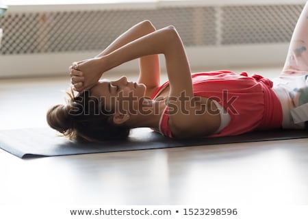 Tired woman finishing gym routine Stock photo © photography33