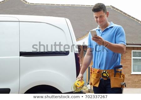 Elektryk telefonu komórkowego budynku portret biały połączenia Zdjęcia stock © photography33