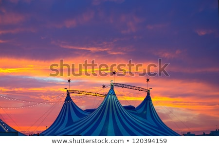 Circus tent in a dramatic sunset sky colorful Stock photo © lunamarina