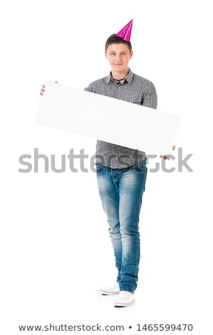 Full length portrait of boy holding blank whiteboard Stock photo © stockyimages