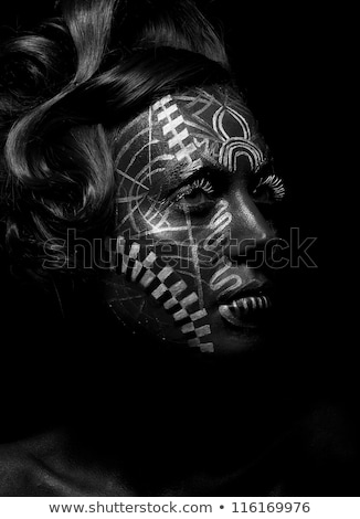Savage religious woman voodoo, tattoo. Tribe. Painted face Stock photo © gromovataya