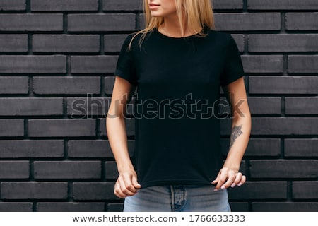 Attractive blond girl in black stock photo © acidgrey