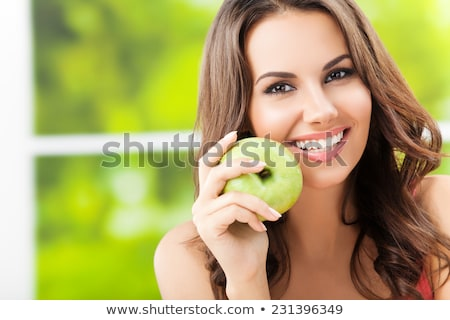 Sorridente jovem morena maçãs isolado preto Foto stock © acidgrey