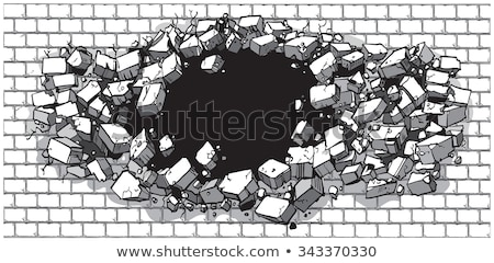 Brick Wall Explodes on Black Background Stock photo © grasycho