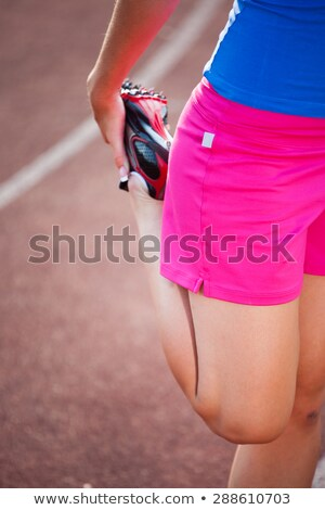 woman stretching before race on track stock photo © wavebreak_media