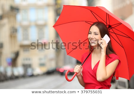 Portrait of a beautiful happy smiling girl with red umbrella Stock photo © Len44ik
