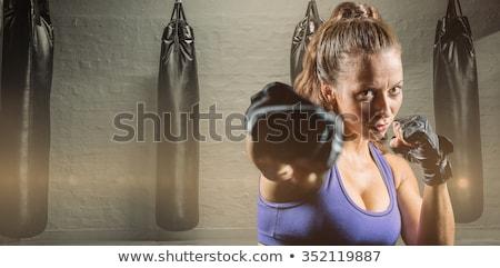 Crossfit woman boxing with red punching bag Stock photo © lunamarina