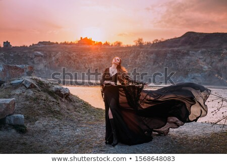 attractive gothic girl in black and red outfit stock photo © elisanth
