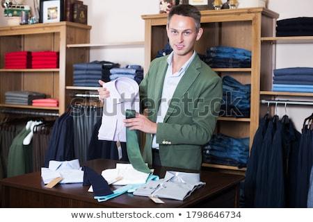 Vásárol póló jóképű fiatalember butik vásárlás Stock fotó © luminastock