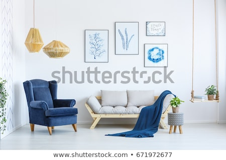 Living room with sofa and blue wall, interior design Stock photo © lunamarina