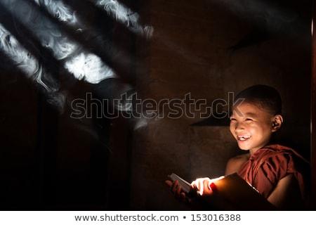 Asian little monk reading book Stock photo © szefei