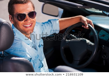 seated young man looking over his sunglasses Stock photo © feedough