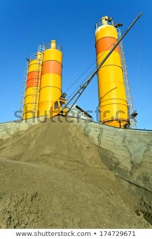 Yellow concrete silos over blue sky Stock photo © gavran333