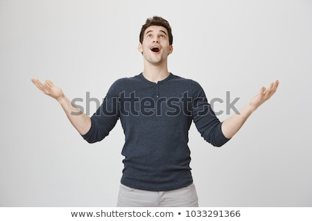 Stock photo: Young man is looking up