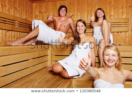 Four friends in sauna of a thermal bath stock photo © Kzenon