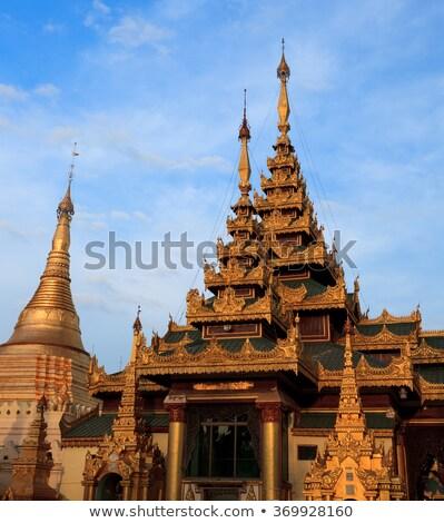 Shwedagon Pagoda Temple shining in the beautiful sunset in Yango Stock photo © weltreisendertj