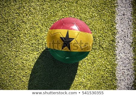 Soccer ball with Ghana flag on pitch Stock photo © stevanovicigor