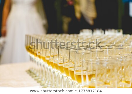 glasses of champagne and bride and groom on background selectiv stock photo © amok