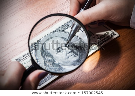 forgery or restoration of banknotes, close-up Stock photo © OleksandrO