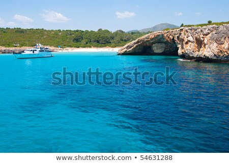 Speed boat in a quiet bay with beach.  Majorca island, Spain  Stock photo © EwaStudio