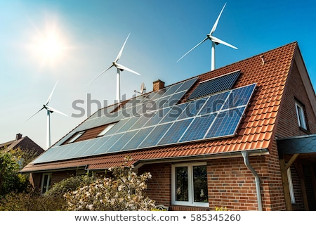 New houses with solar panels and wind generators Stock photo © artjazz