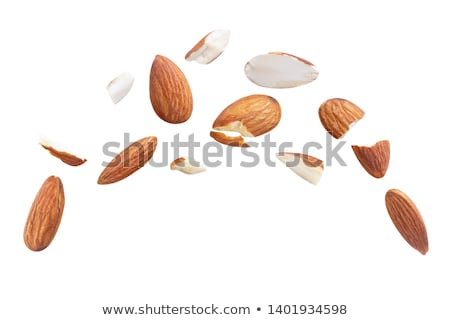 Foto stock: Group Of Brown Almonds Isolated On White