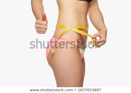 Happy athletic woman measuring perfect shape of beautiful thigh Stock photo © vlad_star