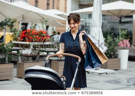Winkelen moeder kinderwagen zwangere vrouw permanente baby Stockfoto © Vg