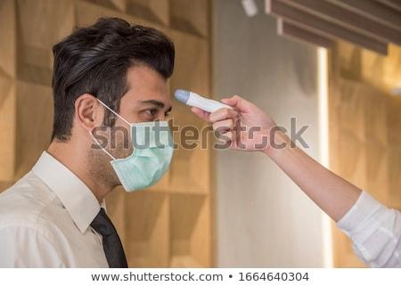 Chorych kobieta temperatura portret bed Zdjęcia stock © deandrobot
