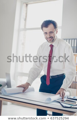 happy businessman in suit touching business scheme Stock photo © dolgachov