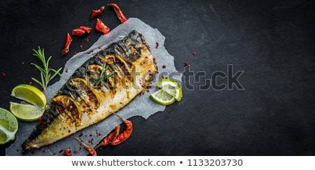 Sült makréla hal gyógynövények citrom tányér Stock fotó © Kayco