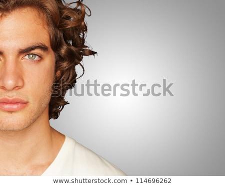 Knap jonge man naar verward witte man Stockfoto © wavebreak_media