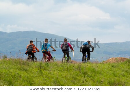 Little boy biking through mountains Stock photo © wavebreak_media