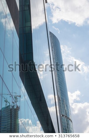 Uncommon high-rise building on blue sky  Stock photo © cherezoff