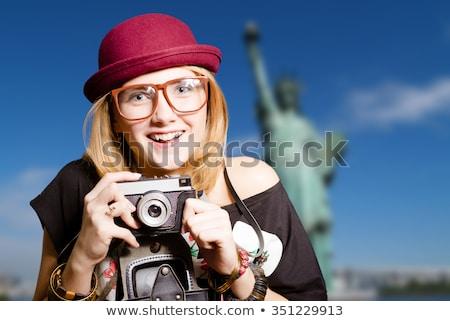 Blond tourist taking photo to Statue of Liberty NYC Stock photo © lunamarina