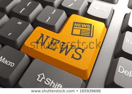 online · oranje · toetsenbord · knop · vinger · voortvarend - stockfoto © tashatuvango